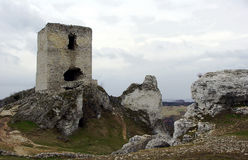 Rocks and ruined medieval castle Royalty Free Stock Image