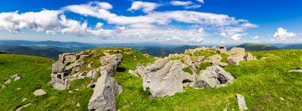 Rocks of Runa mountain. panoramic view. Wonderful cloudscape on a blue sky over the distant mountain range. breathtaking view of mountainous summer landscape royalty free stock photos