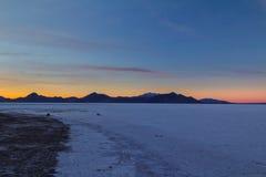 Rocks and Salt. Sunset on the Bonneville Salt Flats in Utah Royalty Free Stock Photos