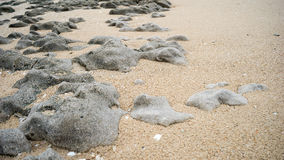 Rocks And Sand on Beach Stock Photo