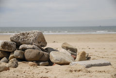 Rocks on sand at beach royalty free stock image