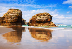 Rocks at sand beach in summer Royalty Free Stock Image