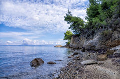 Rocks and sand in a beautiful beach in Chalkidiki, Greece Royalty Free Stock Photo