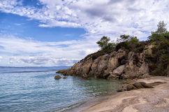 Rocks and sand in a beautiful little beach in Sithonia, Greece Stock Images