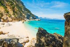Rocks and sand in Cala Mariolu. Orosei Gulf, Sardinia royalty free stock photos