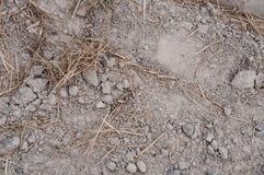 Rocks sand gravel and straw at a construction site Stock Photo