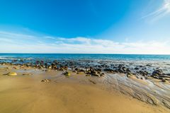 Rocks and sand in Malibu shore. California Royalty Free Stock Images
