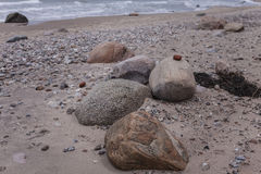Rocks in sand royalty free stock photography