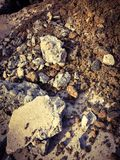 Rocks, sand and soil on the ground. Rocks, sand and soil mixed together on the ground Stock Image