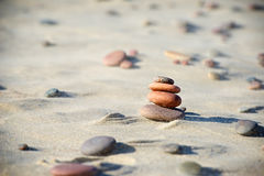 Rocks on the sand. Rocks tower on the beach of baltic sea Stock Image