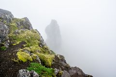 Rocks of a Sandafell hill covered by fog in West Iceland. Rocks of a Sandafell hill covered by fog near Pingeyri in West Iceland Royalty Free Stock Photos