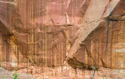 Rocks of sandstone overgrown with plants. royalty free stock photography