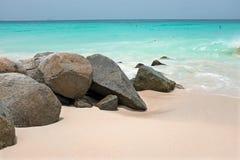 Rocks on a sandy beach on Aruba in the Caribbean Sea. Rocks on a sandy beach on Aruba island in the Caribbean Sea Stock Photo