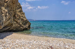 Rocks in a sandy beach in Sithonia, Chalkidiki, Greece Royalty Free Stock Images