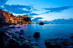 Rocks scilla. Chianalea (Scilla to Reggio Calabria) taken with a long exposure during the blue hour stock images