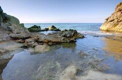 Rocks at sea Stock Images