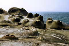 Rocks at the sea. Interesting rock formations close to the sea Royalty Free Stock Photo
