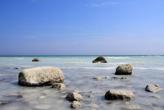 Rocks at sea. Rocks on the shoreline, blue sky and sea Royalty Free Stock Images