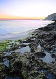 Rocks in the Sea against Beautiful Sunset Stock Photo
