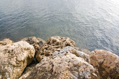 Rocks and sea background Stock Photos
