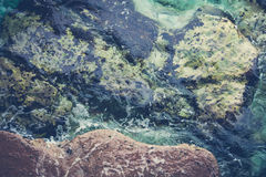 Rocks and sea background Stock Image