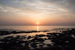Rocks at the sea on beautiful sunrise. Sandstone rocks at the sea on beautiful sunrise Royalty Free Stock Photo