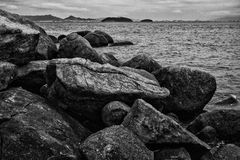 Rocks by the sea. Black and white picture of rocks on the island of Anhatomirim, in Florianopolis, Brazil Stock Images