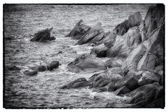 Rocks in the sea. Black and white retro-style photo of  rocks in the sea Royalty Free Stock Images