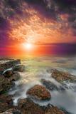 Rocks, sea, bloody sunset. Royalty Free Stock Photography