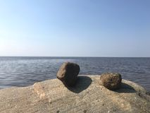 Rocks and sea, blue sky royalty free stock photo