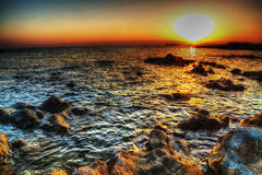 Rocks and sea at dusk Royalty Free Stock Images