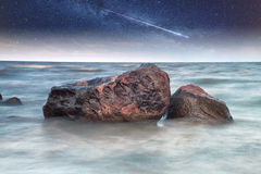 Rocks into the sea. Royalty Free Stock Images