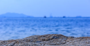 Rocks sea. Focus rocky sea blurred background. Royalty Free Stock Images