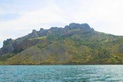Rocks on the sea. Rocks in the sea, forest, Karadag Crimea Koktebel Royalty Free Stock Photos