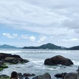 Rocks in sea. Landscape of sea with rocks and a mountain in Ubatuba stock images