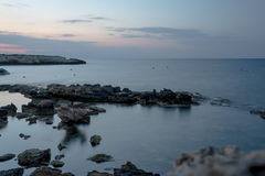 Rocks at the sea, long exposure. Rocks at the blurred sea water, long exposure Royalty Free Stock Photos