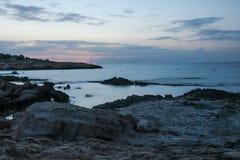 Rocks at the sea, long exposure. Rocks at the blurred sea watter, long exposure Royalty Free Stock Photos