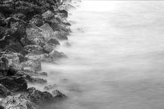 Rocks and sea long exposure landscape.Black and white Royalty Free Stock Photos
