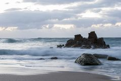 Rocks in the sea. Long exposure photography of rocks in the sea, northwest of Galicia Stock Photos