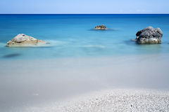 Rocks in the sea, longtime exposure Stock Images