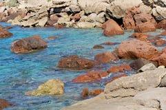 Rocks and sea. Rocks in Lu Bagnu sea water Royalty Free Stock Images