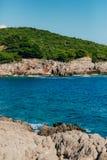 Rocks on the sea in Montenegro. Rocky coast. Wild beach. Dangero Stock Photo