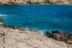 Rocks on the sea in Montenegro. Rocky coast. Wild beach. Dangero Royalty Free Stock Photos