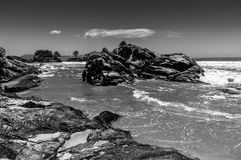 Rocks, sea and moutains. Rocks by the sea in Florianopolis, Santa Catarina State, Brazil Royalty Free Stock Image