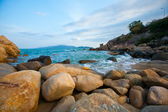 The rocks and the sea. Nha Trang is blessed with one of the world's most beautiful beaches, which runs aside the city, with warm and clear weather almost Stock Photo