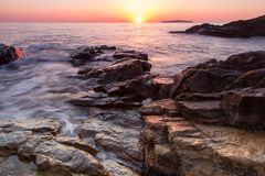 Rocks sea ocean sunrise sunset Stock Images