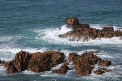 Rocks in the sea off the coast of Guernsey Stock Images