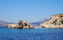 Rocks in the sea off the coast of Plati. A Greek island Royalty Free Stock Image