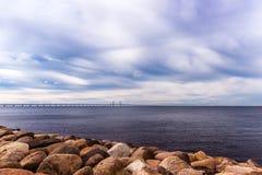 Rocks, sea and Oresund bridge Stock Photos