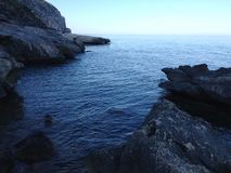 Rocks in the sea, Sardinia royalty free stock images
